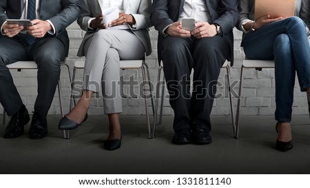 Group of businesspeople sititng in a line