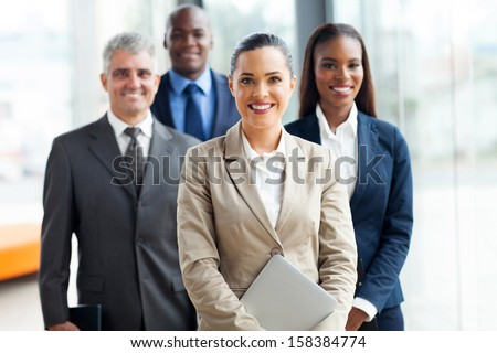 group of businesspeople standing together in office - stock photo