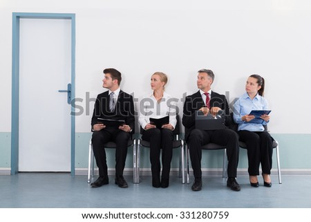 Shutterstock Group Of Businesspeople With Files Sitting On Chair For Giving Interview