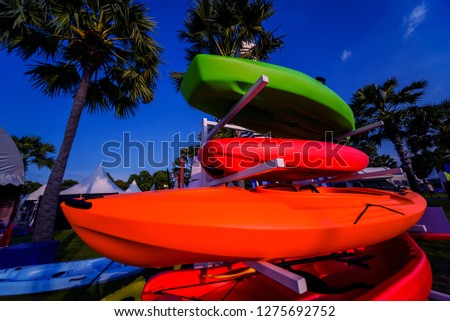 Group of canoes and kayaks on a green grass. Background