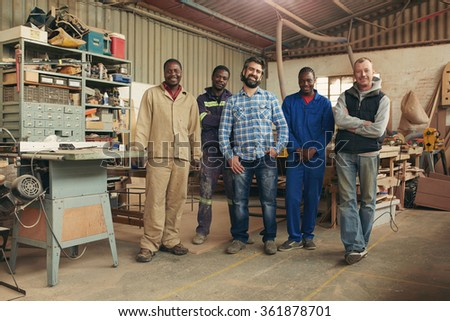 Group of carpenters smiling at the camera