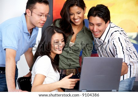 group of casual people on a computer at home