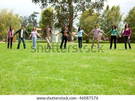 Group of casual people outdoors holding hands