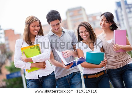 Group of casual students walking and looking happy