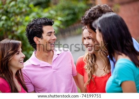 Group of casual young people talking outdoors
