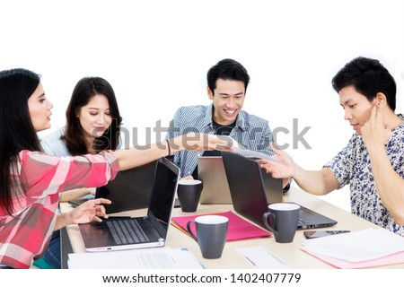 Group of casually dressed business people working together in the studio, isolated on white background #1402407779