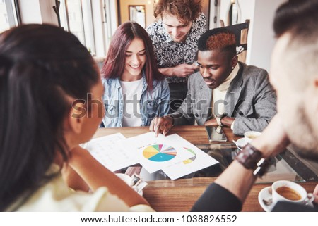 Group of casually dressed businesspeople discussing ideas. Creative professionals gathered for discuss the important issues of the new successful startup project. Teamwork Brainstorming concept. #1038826552