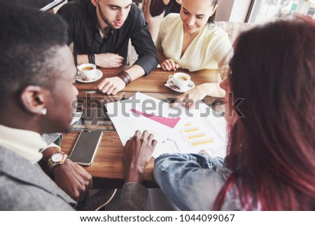 Group of casually dressed businesspeople discussing ideas. Creative professionals gathered for discuss the important issues of the new successful startup project. Teamwork Brainstorming concept. #1044099067
