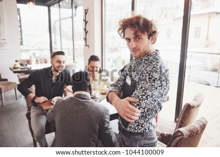 Group of casually dressed businesspeople discussing ideas. Creative professionals gathered for discuss the important issues of the new successful startup project. Teamwork Brainstorming concept. #1044100009