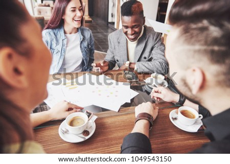 Group of casually dressed businesspeople discussing ideas. Creative professionals gathered for discuss the important issues of the new successful startup project. Teamwork Brainstorming concept. #1049543150