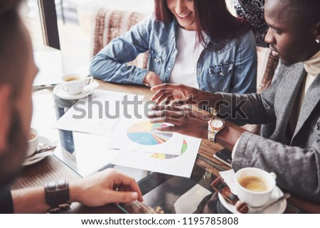 Group of casually dressed businesspeople discussing ideas. Creative professionals gathered for discuss the important issues of the new successful startup project. Teamwork Brainstorming concept. #1195785808