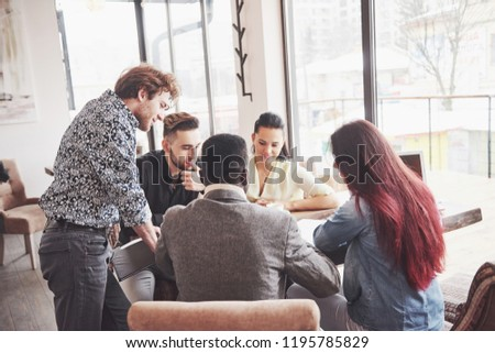 Group of casually dressed businesspeople discussing ideas. Creative professionals gathered for discuss the important issues of the new successful startup project. Teamwork Brainstorming concept. #1195785829