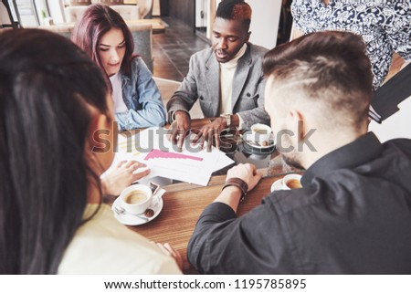 Group of casually dressed businesspeople discussing ideas. Creative professionals gathered for discuss the important issues of the new successful startup project. Teamwork Brainstorming concept. #1195785895