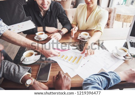 Group of casually dressed businesspeople discussing ideas. Creative professionals gathered for discuss the important issues of the new successful startup project. Teamwork Brainstorming concept. #1219396477