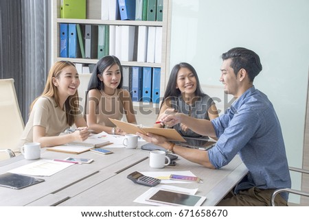 Group of casually dressed businesspeople discussing ideas in the office. Creative professionals gathered at the meeting table for discuss the important issues of the new successful startup project #671658670