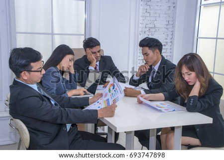 Group of casually dressed businesspeople discussing ideas in the office. Creative professionals gathered at the meeting table for discuss the important issues of the new successful startup project #693747898