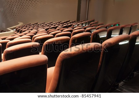 Group of chairs in modern theatre interior