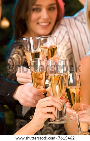 Group of champagne glasses clinking together