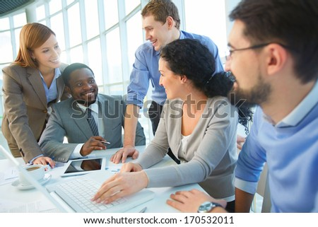 Group of cheerful business partners planning work at meeting #170532011