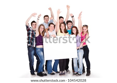 Group of cheerful people holding a banner ad isolated over a white background