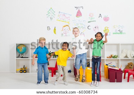 group of cheerful preschool kids jumping up