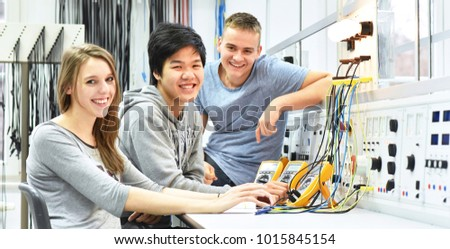 group of cheerful young students in vocational education and training for electronics  #1015845154