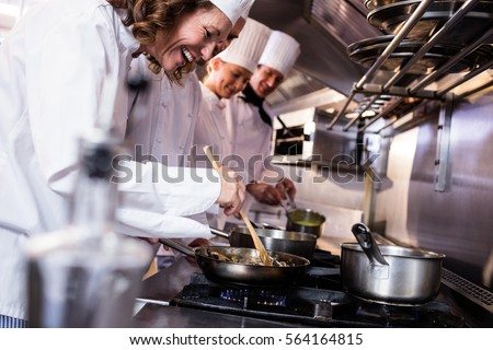 Shutterstock Group of chef preparing food in the kitchen of a restaurant