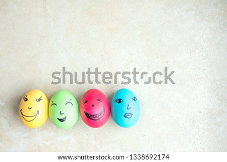 Group of chicken eggs with various emotions.Easter, top view #1338692174