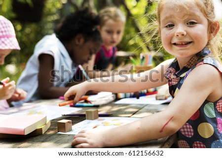 Group of children drawing imagination outdoors #612156632
