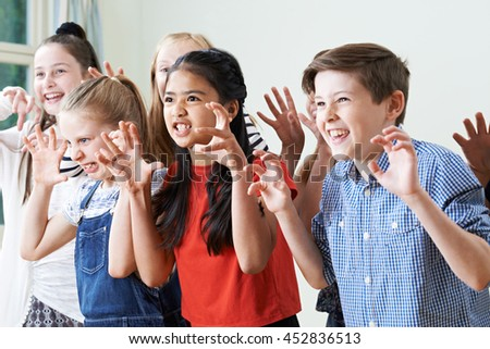Photo of  Group Of Children Enjoying Drama Club Together