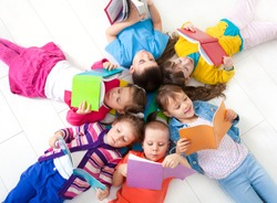 Group of children enjoying reading together