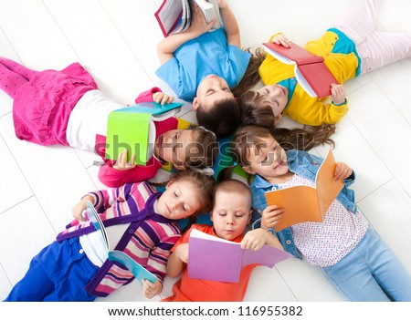 Group of children enjoying reading together