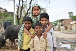 Group of children from rural India smiling and having good time together away from the hustle of urban jungle