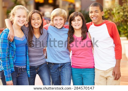 Group Of Children Hanging Out Together In Mall Stock photo ©