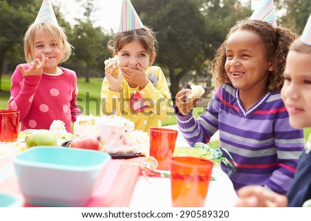 Group Of Children Having Outdoor Birthday Party #290589320