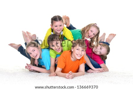 group of children in colorful t-shirts playing together on white background