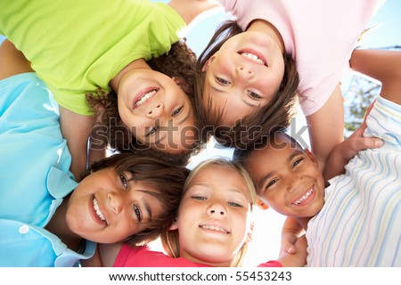 Group Of Children Looking Down Into Camera #55453243