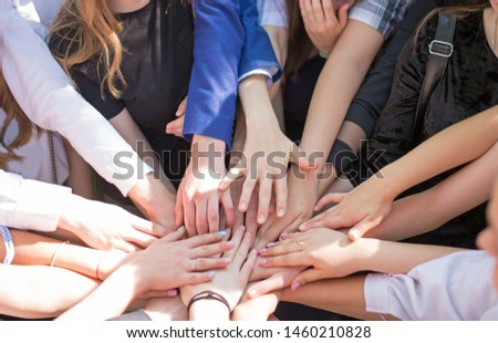 Group of children putting their hands together. Concept teamwork partnership. #1460210828