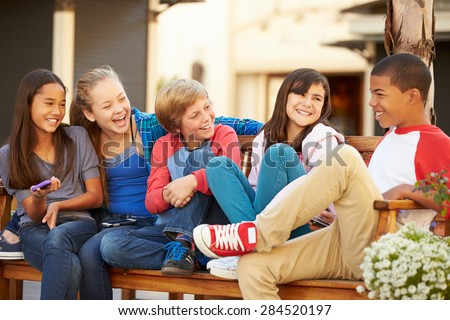 group of children sitting on...