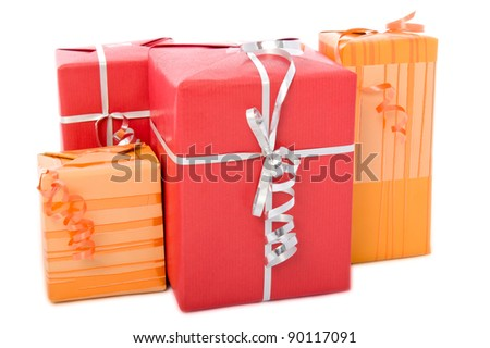 Group of Christmas gift boxes with curly ribbons, isolated on white background