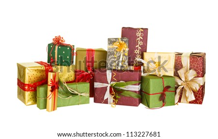 Group of christmas presents nicely decorated with bows and feathers - stock photo