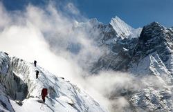 group of climbers on mountains montage to mounts Kangtega and Thamserku, Everest area, Khumbu valley, Nepal