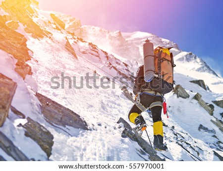 Shutterstock Group of climbers reaches the top of mountain peak. Climbing and mountaineering sport. Teamwork concept.