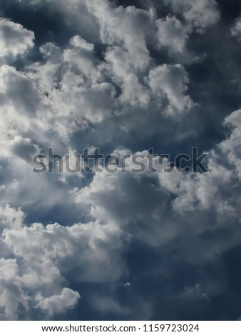 group of clouds with well defined contours, in white color with gray shadows mixed with a blue sky, sao paulo, Brazil #1159723024