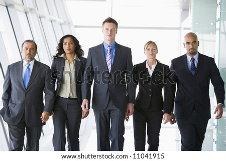 Group of co-workers walking in office space