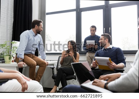 Group of colleagues having a brainstorming session in conference room
