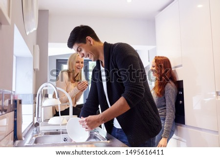 Group Of College Student Friends In Shared House Kitchen Washing Up And Hanging Out Together #1495616411