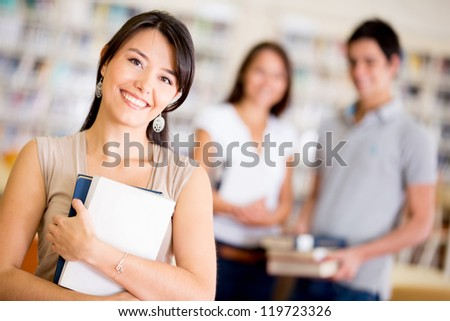 Group of college students at the library smiling