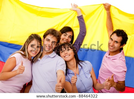 Group of Colombian friends with the flag and thumbs-up