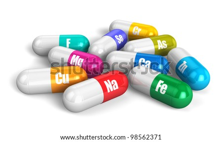 Group of color vitamin pills isolated on white background
